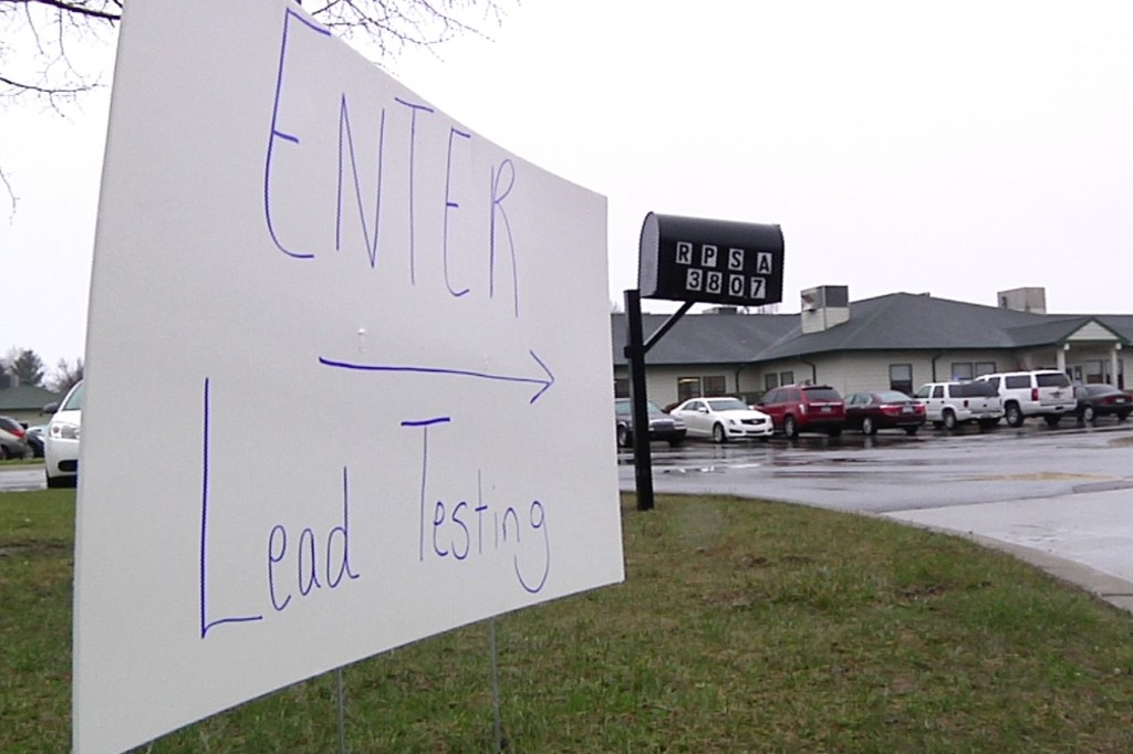 A sign at the entrance to a lead-testing clinic held at Richfield Public School Academy in Flint, Mich. (AP Photo/Mike Householder)