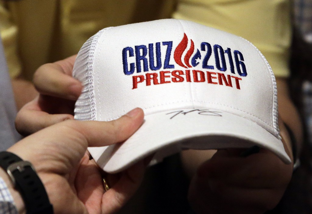 Republican presidential candidate Sen. Ted Cruz, R-Texas, hands an autographed hat to a supporter at Woodrow Wilson Middle School, Sunday, April 24, 2016, in Terre Haute, Ind. (AP Photo/Darron Cummings)