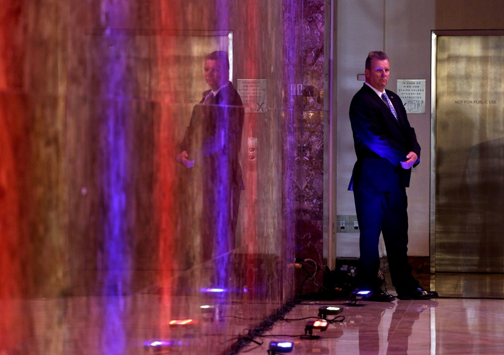 A Secret Service agent stands watch near an elevator before the arrival of Republican presidential candidate Donald Trump at a New York primary night event, Tuesday, April 19, 2016, in New York. (AP Photo/Julie Jacobson)
