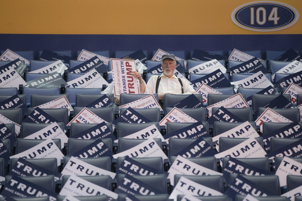 Spectators sit in the stands at the First Niagara Center as they wait for the arrival of Republican presidential candidate Donald Trump ahead of a campaign stop, Monday, April 18, 2016, in Buffalo, N.Y. (AP Photo/John Minchillo)
