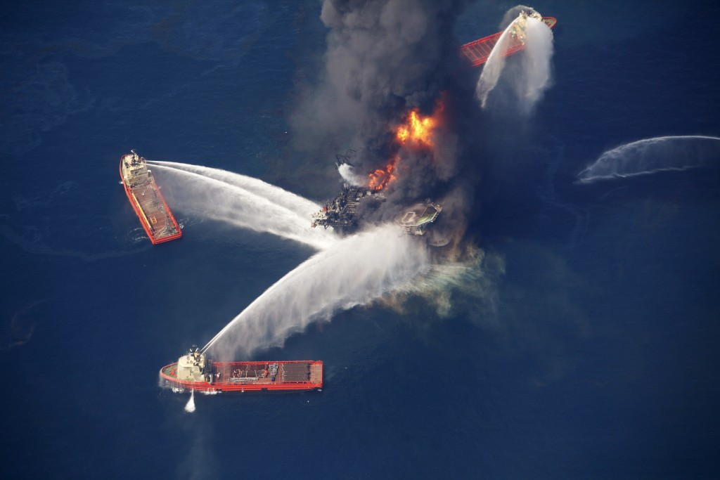 In this April 21, 2010 photo, the Deepwater Horizon oil rig burns in the Gulf of Mexico. (AP Photo/Gerald Herbert, File)