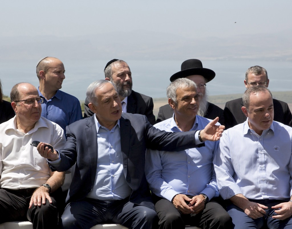 Israeli Prime Minister Benjamin Netanyahu (C front) poses with ministers prior to the weekly cabinet meeting in the Israeli occupied Golan Heights near the ceasefire line between Israel and Syria, April 17, 2016. REUTERS/Sebastian Scheiner/Pool