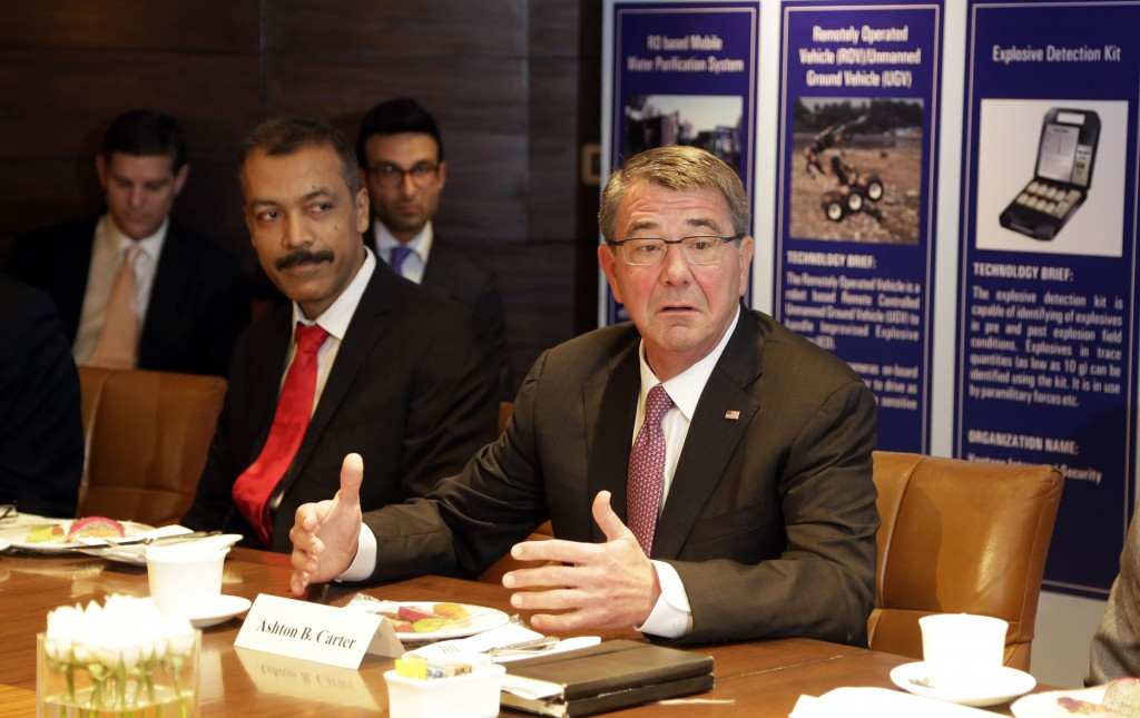 U.S. Defense Secretary Ash Carter, right, speaks at Innovation Roundtable organized by Federation of Indian Chambers of Commerce and Industry, in New Delhi, India, Tuesday, April 12, 2016. (AP Photo/Altaf Qadri)
