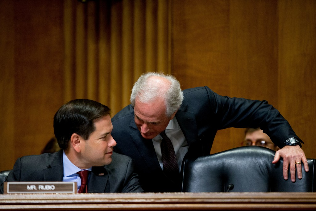 Senate Foreign Relations Committee Chairman Bob Corker, R-Tenn., right, speaks with Sen. Marco Rubio, R-Fla., on Capitol Hill in Washington, Tuesday, April 5, 2016, during the committee's hearing on recent Iranian actions and implementation of the nuclear deal. (AP Photo/Andrew Harnik)