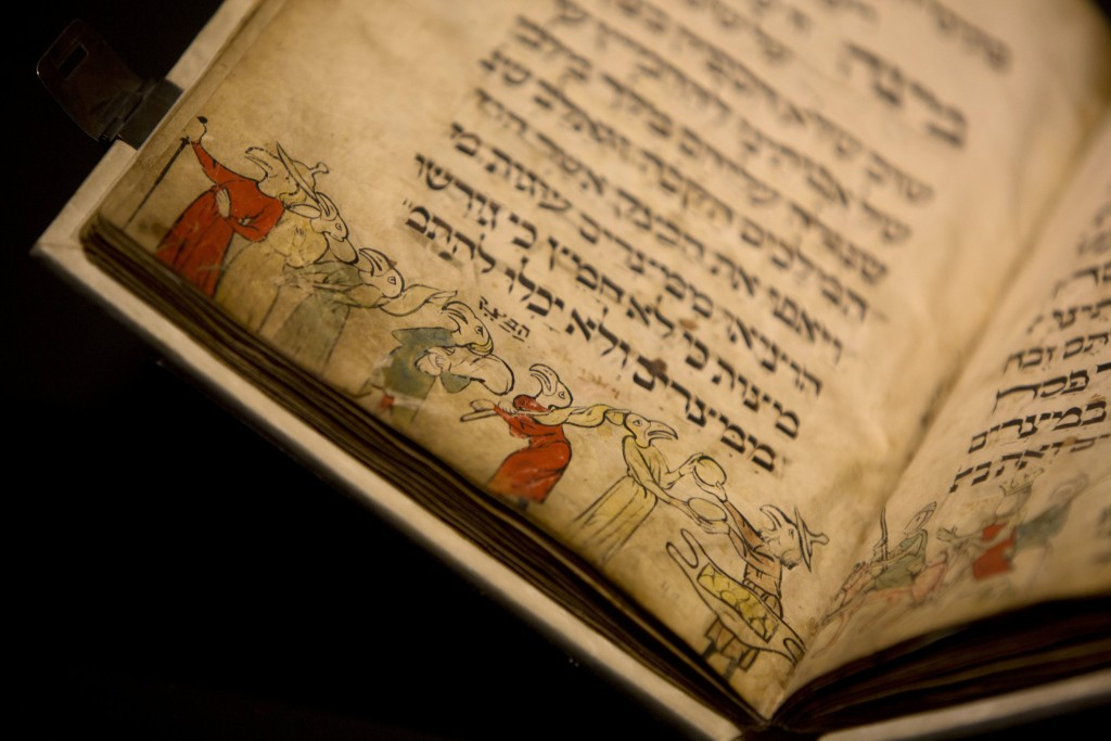 A page of the famed Birds' Head Haggadah is seen on display at the Israel Museum in Yerushalayim. (AP Photo/Sebastian Scheiner)