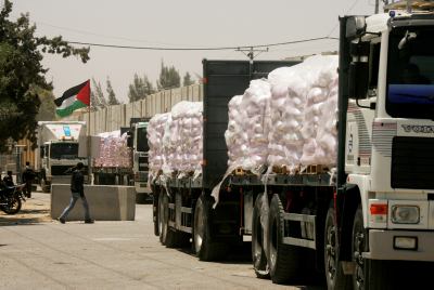 Trucks loaded with food supplies at the Kerem Shalom crossing. Abed Rahim Khatib /Flash90