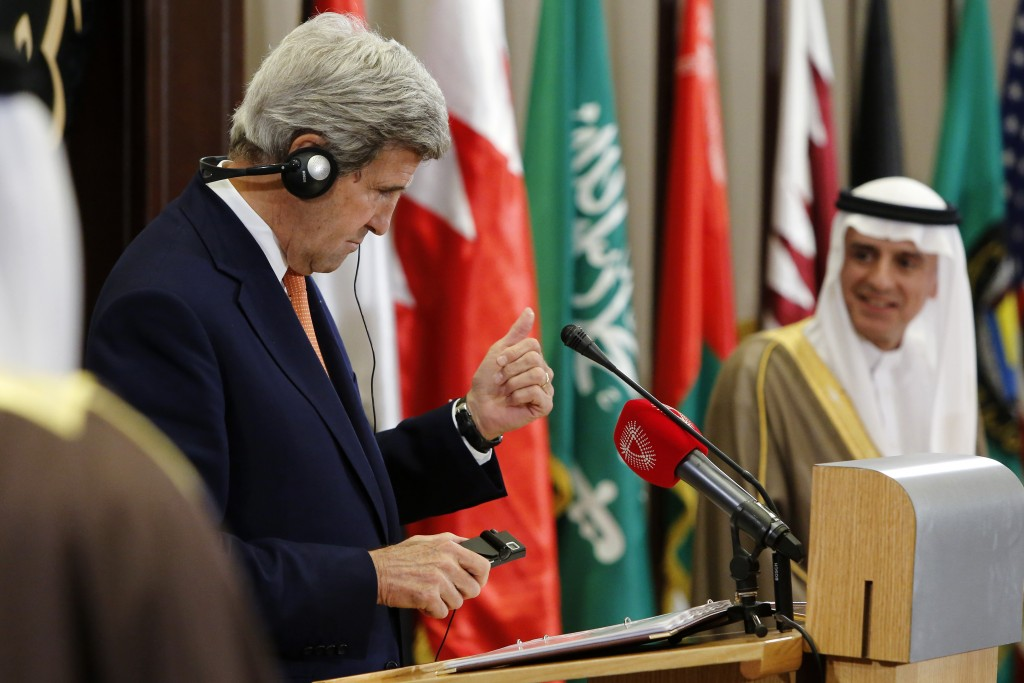 Secretary of State John Kerry gives a thumbs-up to Saudi Arabia Foreign Minister Adel al-Jubeir after a check of his translation headset before their remarks to reporters alongside the Gulf Cooperation Council (GCC) Ministerial meeting in Manama, Bahrain, Thursday, April 7, 2016. (Jonathan Ernst/Pool Photo via AP)