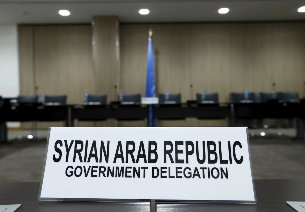 A sign of Syrian government delegation is pictured before a meeting with U.N. mediator Staffan de Mistura during Syria peace talks at the United Nations in Geneva, Switzerland, April 26, 2016. REUTERS/Denis Balibouse