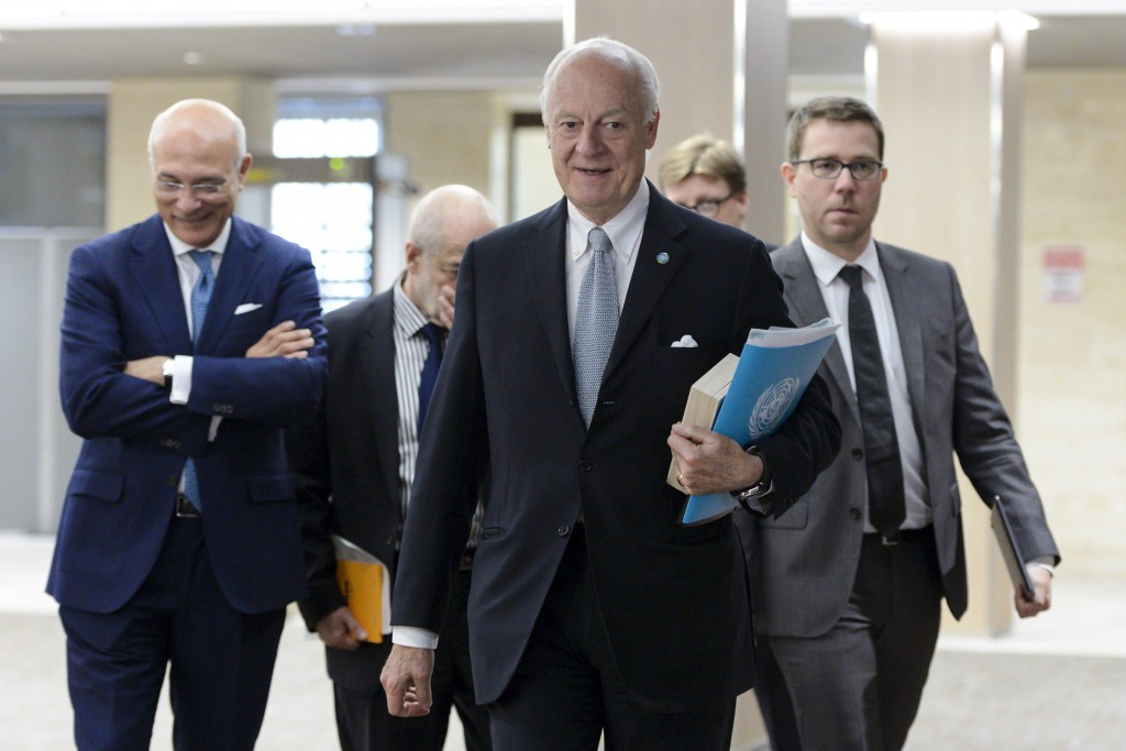 U.N. mediator on Syria Staffan de Mistura (C) arrives for a meeting with the Syrian government delegation during Syria peace talks at the United Nations in Geneva, Switzerland, April 15, 2016.REUTERS/Fabrice Coffrini/Pool