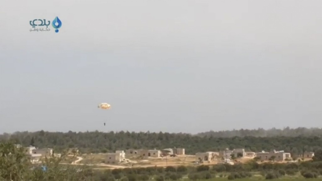 A pilot parachutes from a plane that was shot down, in this still image taken from video footage said to be shot in Al Eiss, Aleppo province, Syria, and uploaded to a social media website on April 5, 2016. Syria's military said the Syrian warplane was shot down by a surface-to-air missile in Aleppo province and that its pilot ejected, state media reported. Social Media Website via Reuters ATTENTION EDITORS - THIS PICTURE WAS PROVIDED BY A THIRD PARTY. FOR EDITORIAL USE ONLY. NOT FOR SALE FOR MARKETING OR ADVERTISING CAMPAIGNS. FOR EDITORIAL USE ONLY. NO RESALES. NO ARCHIVE. THIS PICTURE IS DISTRIBUTED EXACTLY AS RECEIVED BY REUTERS, AS A SERVICE TO CLIENTS.