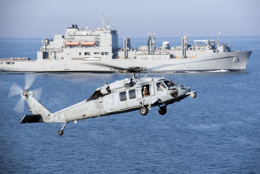 An MH-60S Sea Hawk helicopter prepares to land on the flight deck of aircraft carrier USS Harry S. Truman during a vertical replenishment in the Arabian Gulf in this U.S. Navy picture taken April 6, 2016. The U.S. Navy is leading a 30-nation maritime exercise across Middle Eastern waters which it says will help protect international trade routes against possible threats, including from Islamic State and al Qaeda. Picture taken April 6, 2016. REUTERS/U.S. Navy/Mass Communication Specialist 3rd Class Justin R. Pacheco/Handout via Reuters THIS IMAGE HAS BEEN SUPPLIED BY A THIRD PARTY. IT IS DISTRIBUTED, EXACTLY AS RECEIVED BY REUTERS, AS A SERVICE TO CLIENTS. FOR EDITORIAL USE ONLY. NOT FOR SALE FOR MARKETING OR ADVERTISING CAMPAIGNS