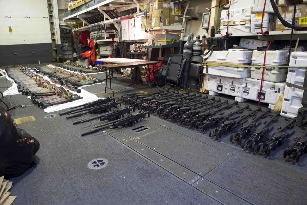 This photo released by the U.S. Navy taken on March 31, 2016 shows a cache of weapons assembled on the deck of the guided-missile destroyer USS Gravely (DDG 107). (U.S. Navy Photo by Mass Communication Specialist 2nd Class Darby C. Dillon via AP)