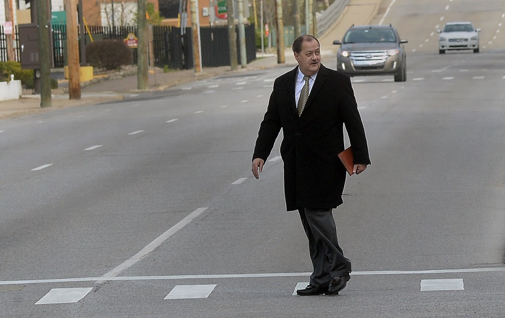 Former Massey Energy CEO Don Blankenship heading to the courthouse in Charleston, W.V., for his sentencing on Wednesday. (F. Brian Ferguson/The Gazette-Mail via AP)