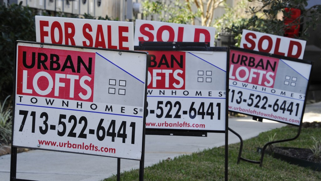'For Sale' signs outside new townhouses in Houston. (AP Photo/Pat Sullivan)