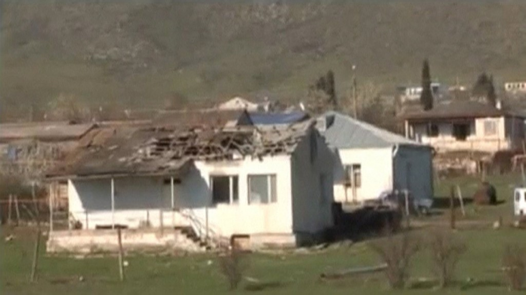 A house which was damaged during clashes between Armenian and Azeri forces is seen in Nagorno-Karabakh region, which is controlled by separatist Armenians, in this still image taken from video provided by Nagorno-Karabakh region Defence Ministry April 2, 2016. REUTERS/Nagorno-Karabakh Military Handout via Reuters TV ATTENTION EDITORS - THIS PICTURE WAS PROVIDED BY A THIRD PARTY. REUTERS IS UNABLE TO INDEPENDENTLY VERIFY THE AUTHENTICITY, CONTENT, LOCATION OR DATE OF THIS IMAGE. EDITORIAL USE ONLY. NOT FOR SALE FOR MARKETING OR ADVERTISING CAMPAIGNS. NO RESALES. NO ARCHIVE. THIS PICTURE IS DISTRIBUTED EXACTLY AS RECEIVED BY REUTERS, AS A SERVICE TO CLIENTS. TPX IMAGES OF THE DAY