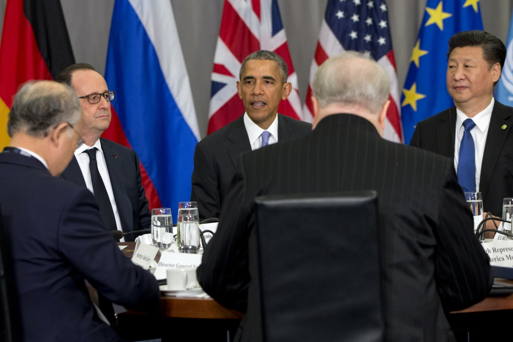French President Francois Hollande, left, and Chinese President Xi Jinping, right, listen as President Barack Obama speaks at the Nuclear Security Summit in Washington on Friday. (AP Photo/Jacquelyn Martin)
