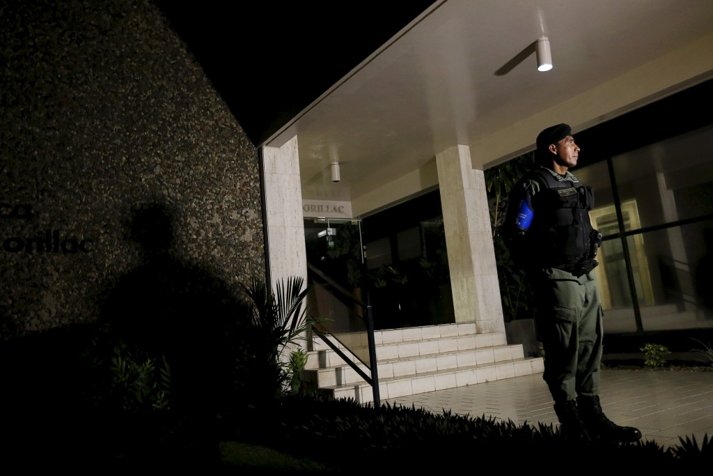 Police officers stand guard at the entrance of Mossack Fonseca law firm office late night in Panama City April 12, 2016. REUTERS/Carlos Jasso