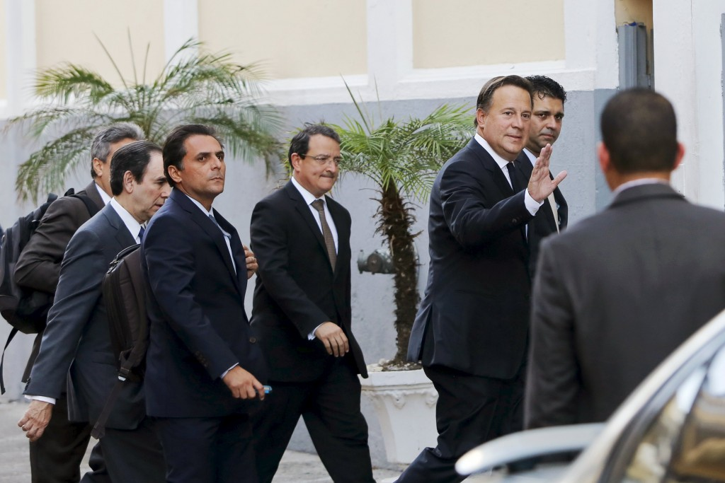 Panama President Juan Carlos Varela waves to the media as he arrives for a meeting with various ambassadors to Panama, at the Foreign Affairs building in Panama City April 6, 2016. REUTERS/Carlos Jasso
