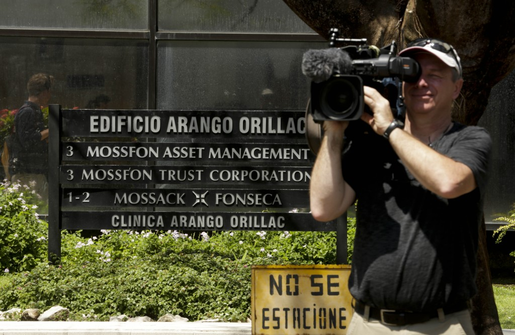 """A cameraman films outside the Arango Orillac Building that lists the Mossack Fonseca law firm in Panama City, Tuesday, April 5, 2016. Millions of confidential documents were leaked from the Panama-based law firm, coined the """"panama papers,"""" revealing details of how some of the globe's richest people funnel their assets into secretive shell companies set up here and in other lightly regulated jurisdictions. (AP Photo/Arnulfo Franco)"""