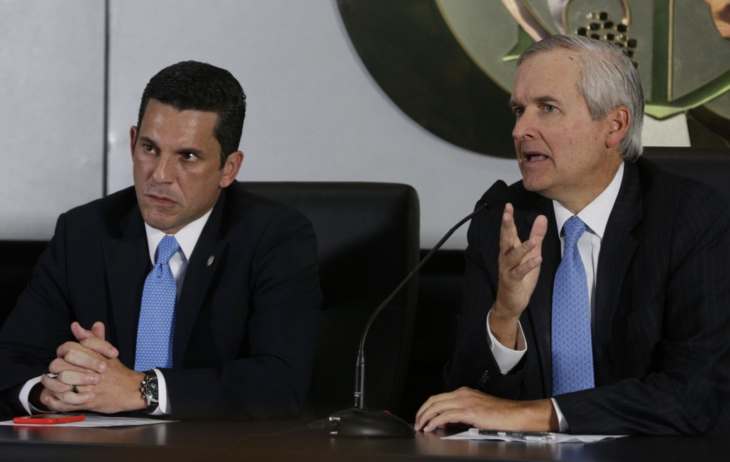 """Panama's Cabinet Chief Alvaro Aleman, right, and Deputy Foreign Minister Luis Hincapie give a press conference regarding the """"panama papers"""" in Panama City, Tuesday, April 5, 2016. Millions of confidential documents were leaked from the Panama-based law firm, coined the """"panama papers,"""" revealing details of how some of the globe's richest people funnel their assets into secretive shell companies set up here and in other lightly regulated jurisdictions. President Juan Carlos Varela has promised to cooperate with any judicial investigations stemming from the leaked data. (AP Photo/Arnulfo Franco)"""