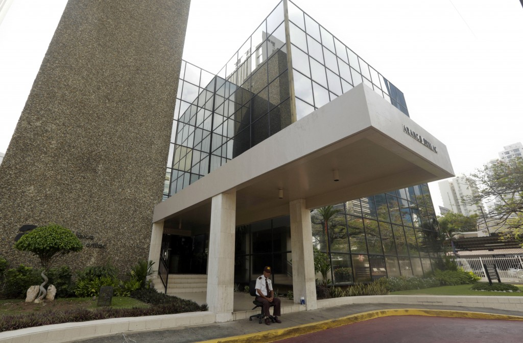 A security guard sit outside the Mossack Fonseca law firm in Panama City, Sunday, April 3, 2016. German daily Sueddeutsche Zeitung says it has obtained a vast trove of documents detailing the offshore financial dealings of the rich and famous. The International Consortium of Investigative Journalism says the latest trove contains includes nearly 40 years of data from the Panama-based law firm, Mossack Fonseca. The company didnít immediately respond to a request for comment. (AP Photo/Arnulfo Franco)