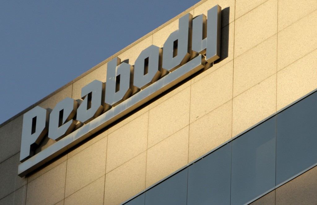 FILE - This Oct. 19, 2009, file photo shows Peabody Energy headquarters in St. Louis. Peabody Energy, hurt by weak demand for coal, says it didn't have the cash to pay a debt payment due Tuesday, March 15, 2016, and warned that it may have to file for Chapter 11 bankruptcy protection. (AP Photo/Jeff Roberson, File)