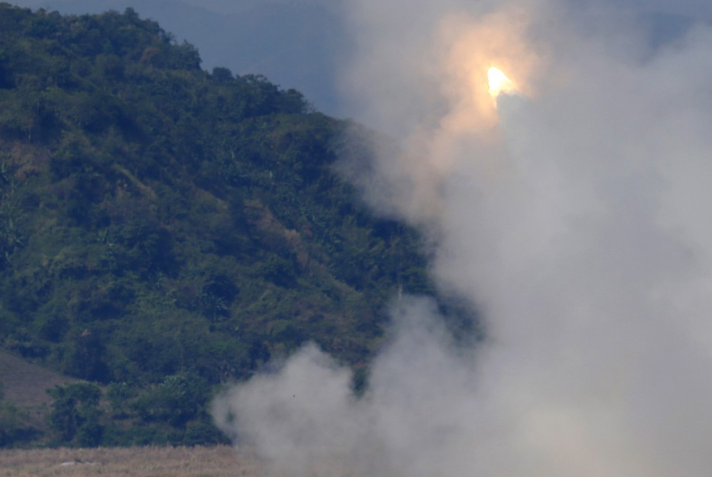 "A US-made HIMARS (High Mobility Advanced Rocket System) fires at a target during the highlight of the 11-day joint US-Philippines military exercise dubbed ""Balikatan 2016"" (Shoulder-To-Shoulder 2016) Thursday, April 14, 2016 at Crow Valley, Tarlac province north of Manila, Philippines. U.S. Defense Secretary Ash Carter arrived in the country Wednesday for talks with President Benigno Aquino III and other top defense and military officials and to visit two military camps being utilized for the exercise under the Enhanced Defense Cooperation Agreement or EDCA.(AP Photo/Bullit Marquez)"