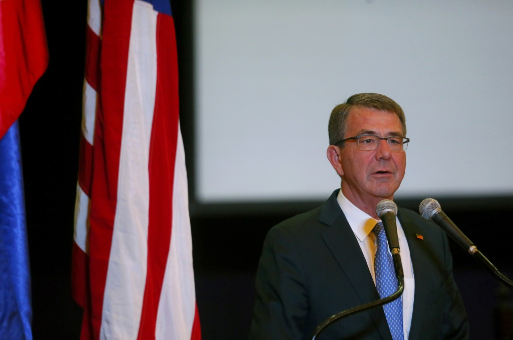 "U.S. Defense Secretary Ash Carter addresses top military and defense officials during the closing ceremony of the 11-day joint U.S.-Philippines military exercise dubbed ""Balikatan 2016"" (Shoulder-To-Shoulder 2016) Friday, April 15, 2016 at Camp Aguinaldo in suburban Quezon city, northeast of Manila, Philippines. Carter is visiting the aircraft carrier USS John C. Stennis sailing in the South China Sea Friday. (AP Photo/Bullit Marquez)"