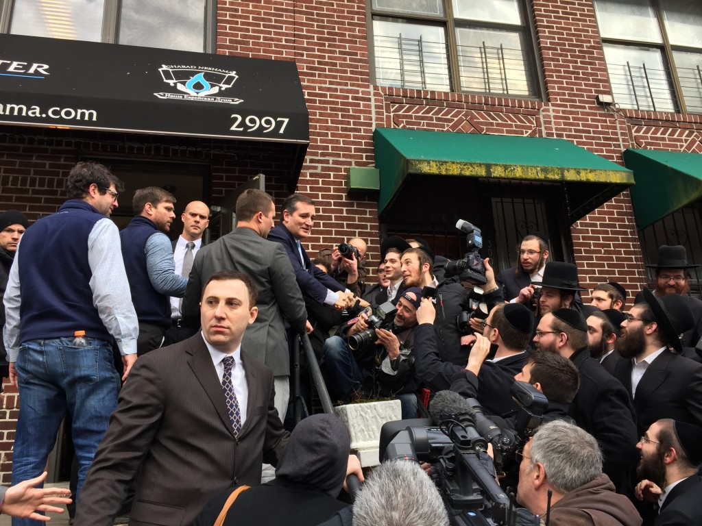 Senator Ted Cruz, a GOP candidate for president, is greeted by the crowd outside the Chabad Neshama center on Ocean Parkway, April 7. Cruz spent a little time baking matzos inside the center.