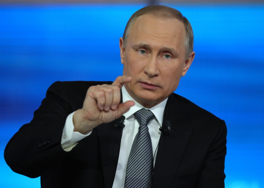 Russian President Vladimir Putin gestures during his annual televised call-in show in Moscow on Thursday, April 14, 2016. (Sputnik, Kremlin Pool Photo via AP)