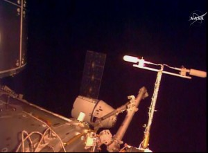 In this frame taken from video from NASA TV, the SpaceX Dragon cargo ship is captured by a robot arm from the International Space Station on Sunday. (NASA TV via AP)