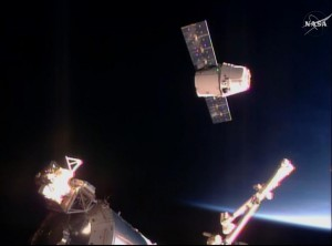In this frame taken from video from NASA TV, the SpaceX Dragon cargo ship approaches the International Space Station on Sunday. (NASA TV via AP)
