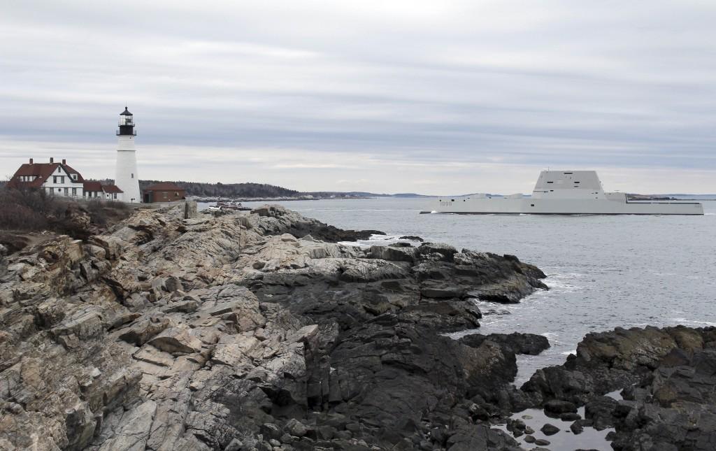 The USS Zumwalt passes Portland Headlight in Cape Elizabeth, Maine. (Ben Davis via AP)