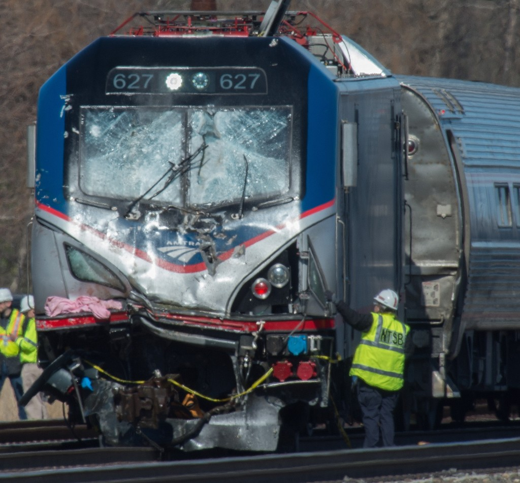 An National Transportation Safety Board staffer inspects the engine of Amtrak Train 89 which hit a construction vehicle on the tracks and derailed in Chester, Pa., Sunday, April 3, 2016. The train was heading from New York to Savannah, Ga. (Clem Murray/The Philadelphia Inquirer via AP)