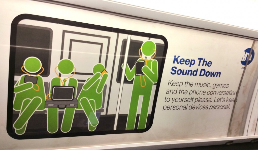 A placard in a subway car moving beneath the streets of New York City, part of an MTA campaign exhorting riders to be more considerate of each other. (AP Photo/Verena Dobnik, File)