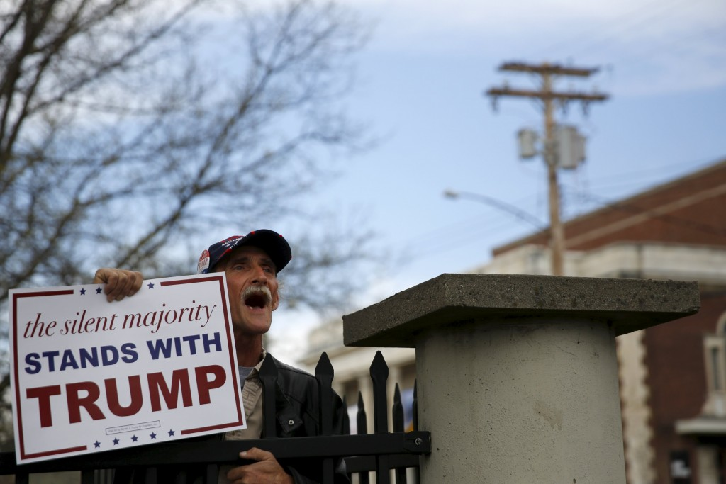 A Donald Trump supporter yells at ant-Trump protesters following a campaign rally for Republican U.S. presidential candidate Donald Trump at The Klein Memorial Auditorium in Bridgeport, Connecticut, U.S., April 23, 2016. REUTERS/Andrew Kelly