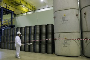 A worker checks the radiation level on barrels in a storage of nuclear waste taken from the 4th unit destroyed by explosion at the Chernobyl nuclear power plant. (AP Photo/Efrem Lukatsky)