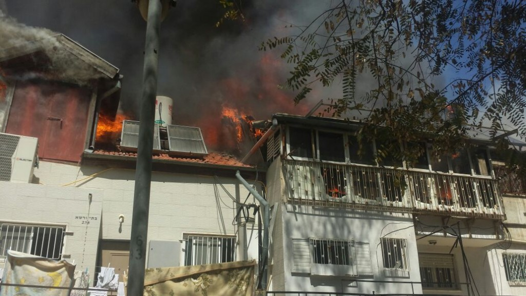 The burning houses in Meah Shearim, Monday afternoon. (Fire Brigade)