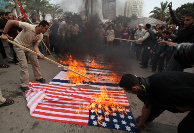 Gaza Arabs burn American and Israeli flags (Photo by Wissam Nassar/Flash 90.)