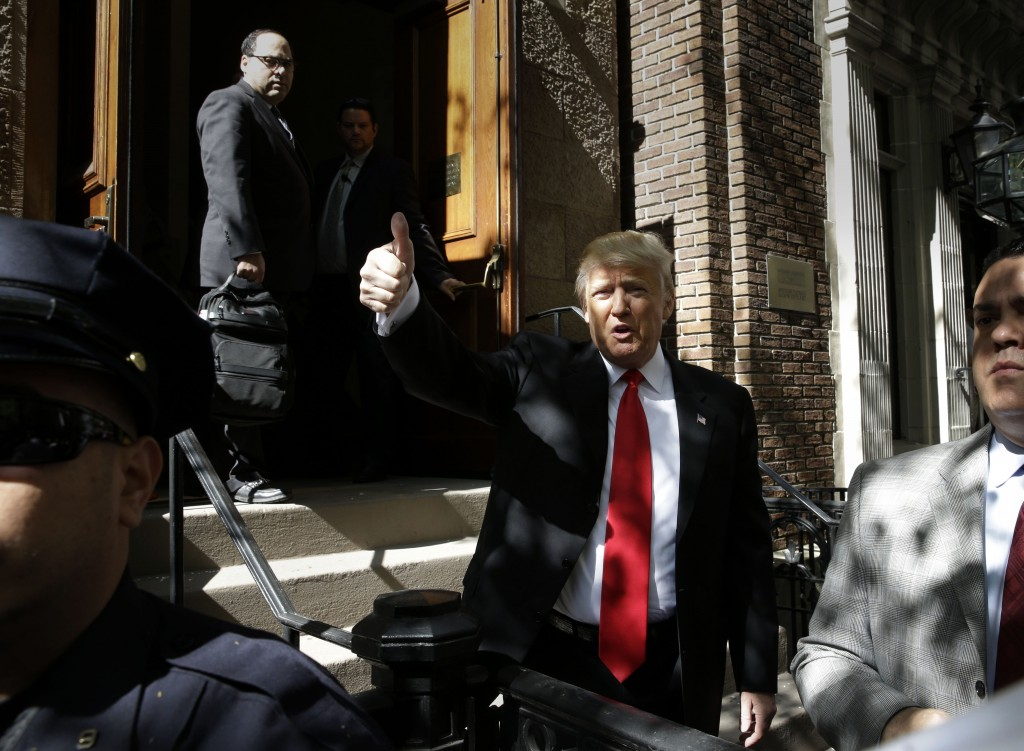 Donald Trump arrives at his voting location in New York on Tuesday morning. (AP Photo/Seth Wenig)