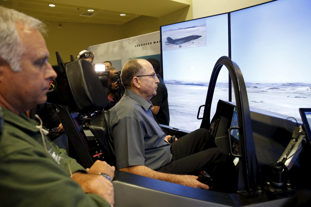 Defence Minister Moshe Yaalon sits in a F-35 simulator during a visit to the Israeli Air Force house in Herzliya. (Baz Ratner/Reuters)