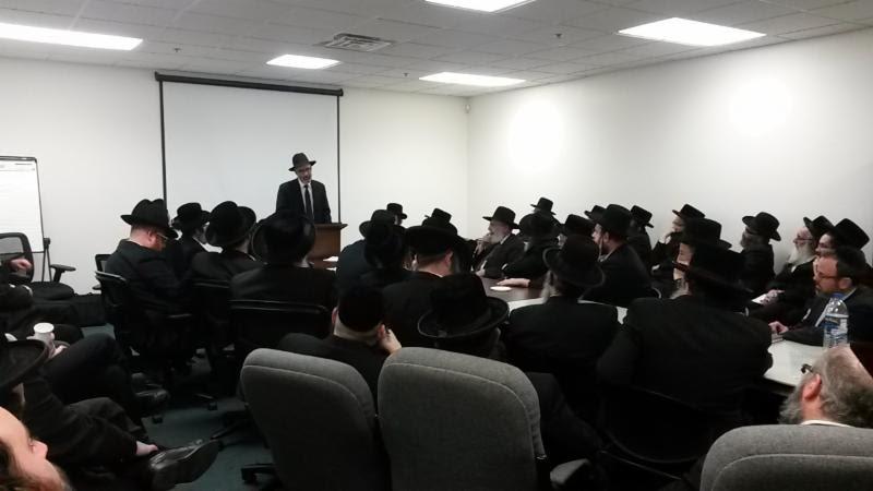Rabbi Zwiebel addressing the yeshiva leaders. (Agudath Israel)