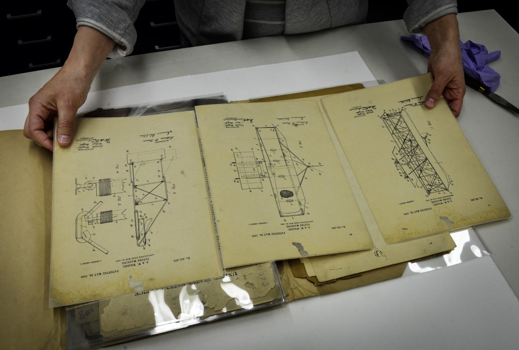 National Archives conservators with the patent documents for the Wright brothers' flying machine, lost for 36 years and recently found. (Bill O'Leary/Washington Post photo)