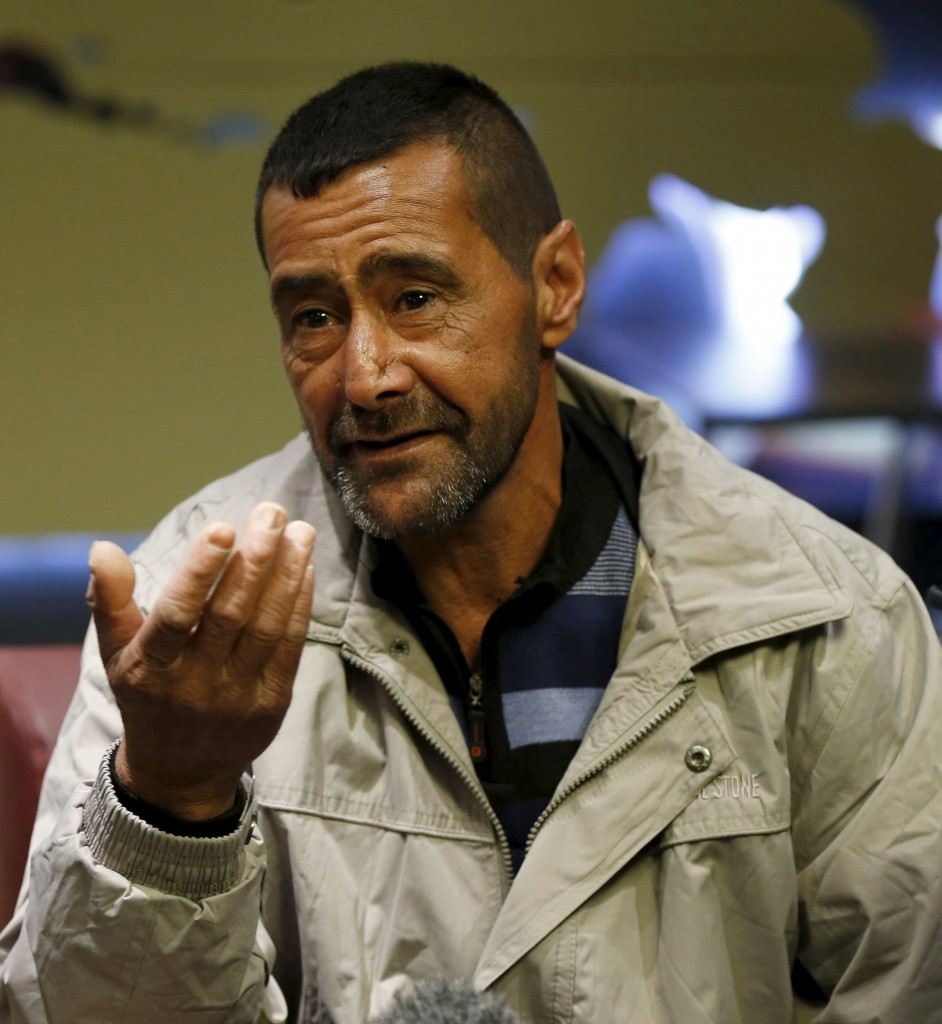 Syrian refugee Ahmad al Aboud, who will be resettled in the United States with his family as part of a refugee admissions program, speaks to the media as he waits to board plane at the Queen Alia International Airport in Amman, Jordan, on Wednesday. (Reuters/Muhammad Hamed)