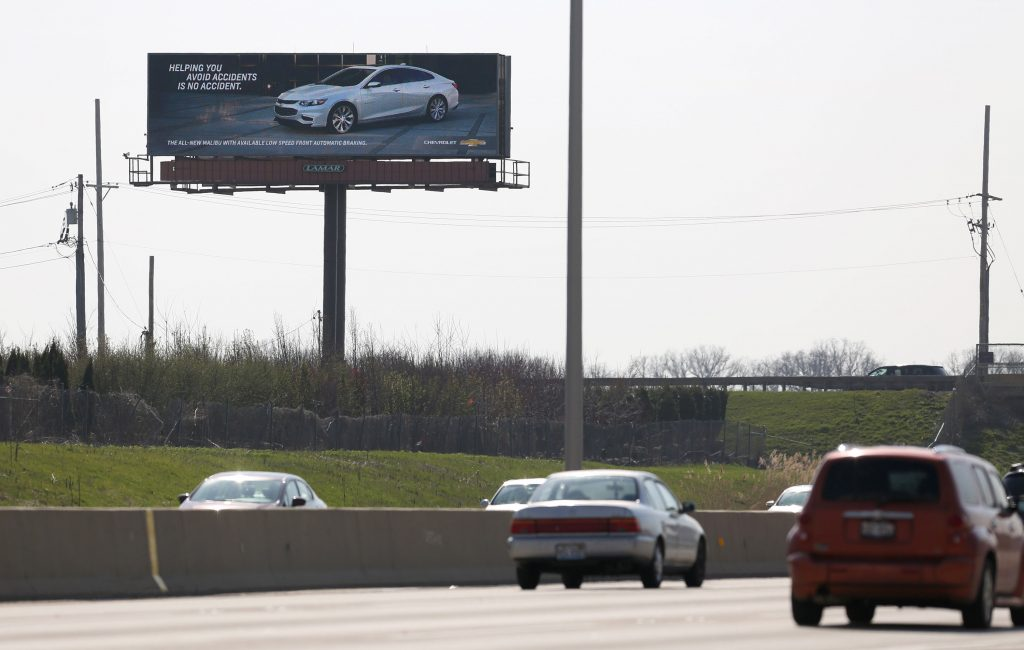 An interactive billboard on Interstate 88 near Eola Road in Aurora, Ill., touts the Chevy Malibu. The sign uses vehicle recognition technology to identify competing sedans and display ads aimed at their drivers. (Abel Uribe/Chicago Tribune/TNS)