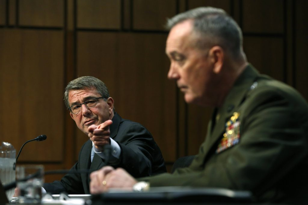 U.S. Secretary of Defense Ash Carter (L) defers to Chairman of the Joint Chiefs of Staff U.S. Marine General Joseph Dunford as they testify on operations against the Islamic State, on Capitol Hill. (Jonathan Ernst/Reuters)