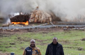 Kenya's President Uhuru Kenyatta (R) and Gabon's President Ali Bongo Ondimba pose for a photograph after lighting the elephant tusks at the Nairobi National Park on Saturday. (Reuters/Thomas Mukoya)