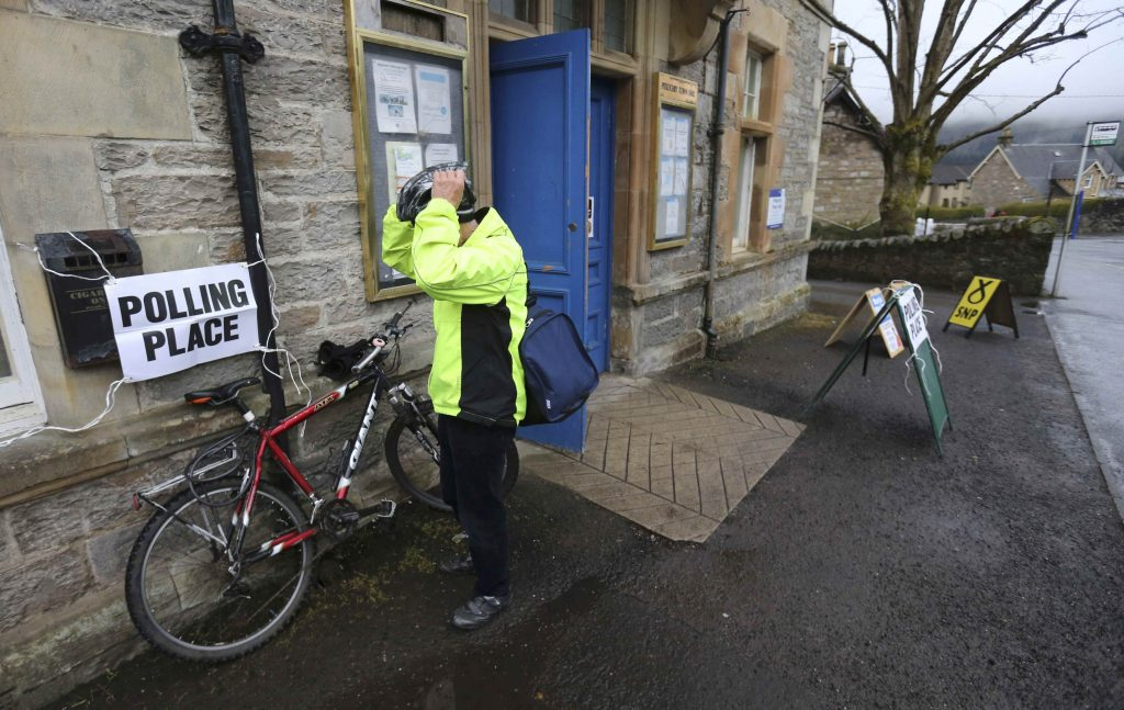 A voter leaves after casting his vote in, Britain May 5, 2016. (Russell Cheyne/Reuters)