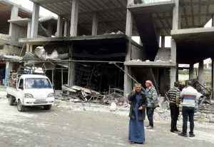 The aftermath of suicide-bomb attacks in Homs, Syria, on Thursday. (SANA/Handout via Reuters)