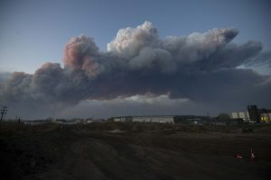 A massive plume of smoke stretches over Fort McMurray, Alberta. (Chris Schwarz/Government of Alberta/Handout via Reuters)